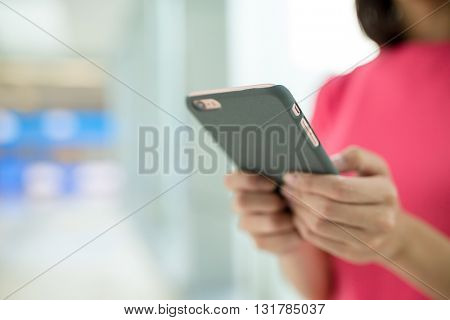 Woman touch on smart phone