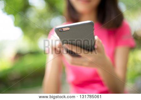 Woman sending sms on smart phone