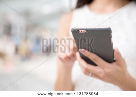 Woman surfing internet on mobile phone