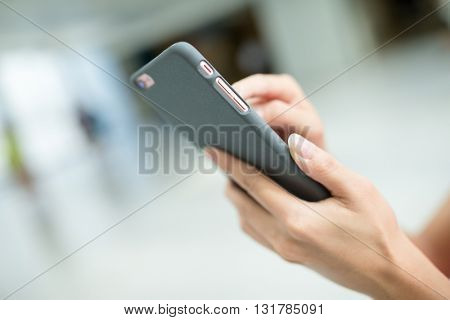Woman touch on mobile phone