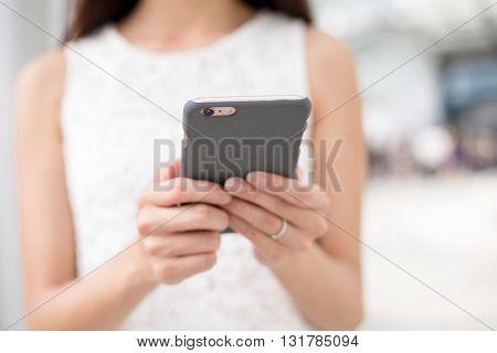 Woman browsing mobile phone