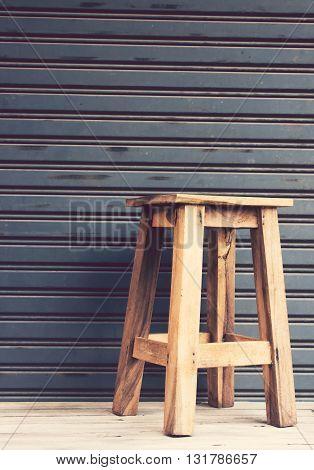 VintageWooden chairs on the wooden floor with Metal sheet slide door