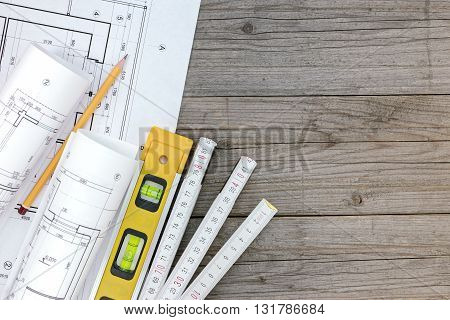 Architectural Blueprints With Contractor Work Tools With Floor Plan On Wooden Desk