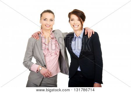 Two women embracing each other.