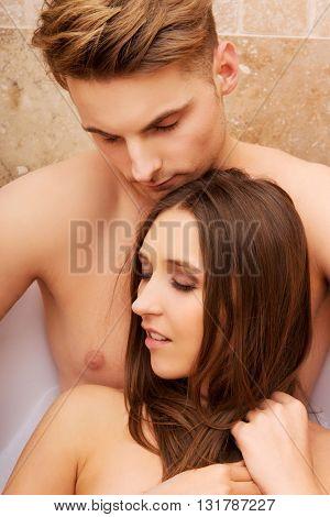 Beautiful young couple relaxing in a bath.