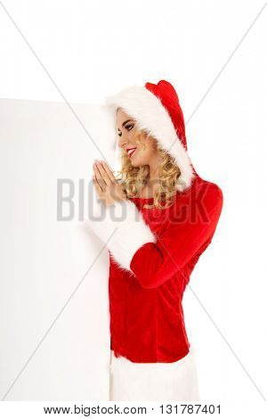 Santa woman holding white empty banner