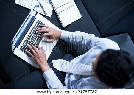 Asian businessman or freelancer working with laptop