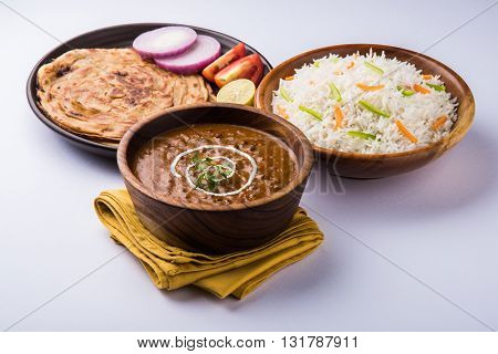 Dal makhani or dal makhni a Buttery Lenti made up of black gram, served with indian bread or chapati and rice
