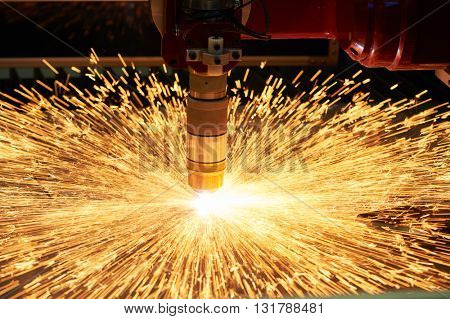plasma or laser cutting metalworking. Technology of flat sheet metal steel material processing with sparks