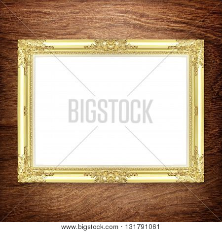 Antique gold frame on wooden wall ;. Empty picture frame on white wooden wall.