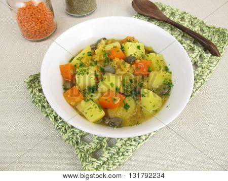 Lentil soup with potatoes, carrots and capers