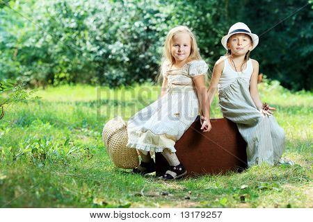 Two beautiful children walking together. Retro style.
