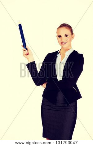 Business woman pointing for copyspace or something with huge pen