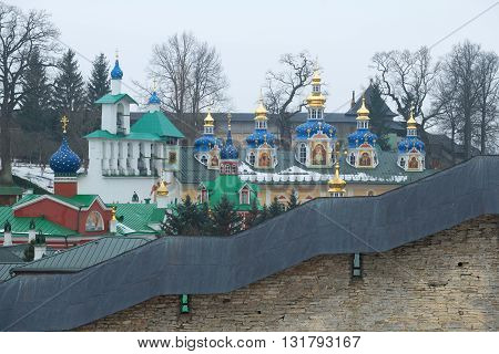 Dome of the Holy Dormition Pskovo-Pechersky monastery, a cloudy day in february. Pskov region, Russia