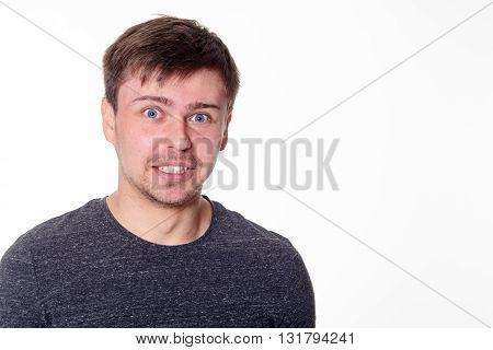 Excited young man with blue eyes isolated on white with space for text