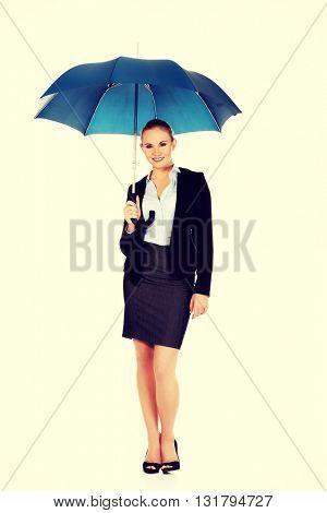 Blonde business woman holding an umbrella
