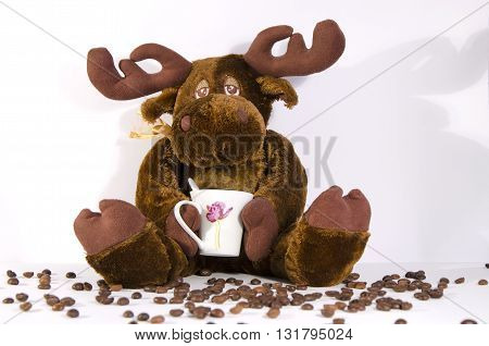 toy deer with the сup of coffee
