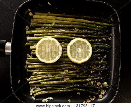 wild asparagus recipe with garlic and lemon in a pan just for eating