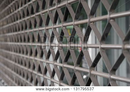Detail of rolling shutter blinds in front of a store in Bangkok Thailand. Business and security concept.
