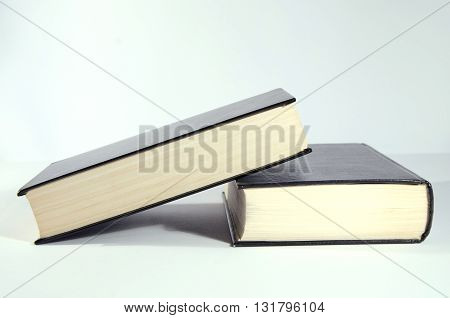 Two closed book`s with black covers. Book`s close up