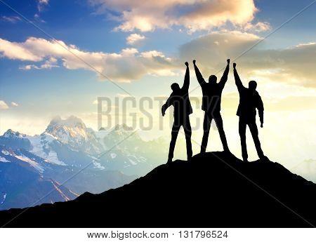 Team on the peak of mountain success