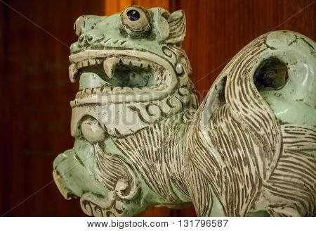 Chinese ceramic lion on public display. This mythical creature is believed to hold a protective role in the Orient.