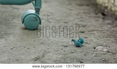 backgrounds, dirty, ugly, background the structure old asphalt, gray color, a wheel of a baby carriage in a corner, a children's toy, blue color, rolls, dirty