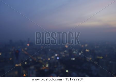 Blurred aerial view of cityscape on warm light sundown Bangkok Thailand