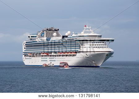KOH SAMUI THAILAND - DECEMBER 09 2015 : Large cruise ship Sapphire Princess in sea water near island Koh Samui Thailand. Sapphire Princess was built in Japan and completed in 2004