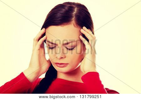 Young beautiful woman with headache