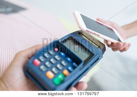 Woman making payment through smartphone