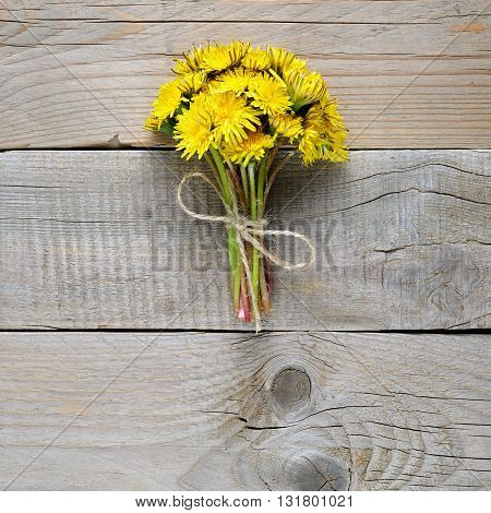 Bouquet of dandelion flowers on table top view