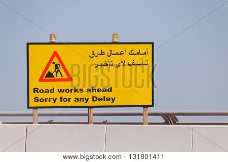 road sign Road Works Ahead in English and Arabic
