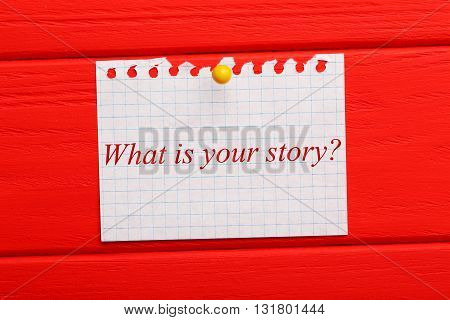 Sheet of paper on red wooden background, what is your story