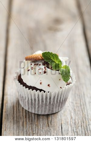 Chocolate Cupcake On A Grey Wooden Table