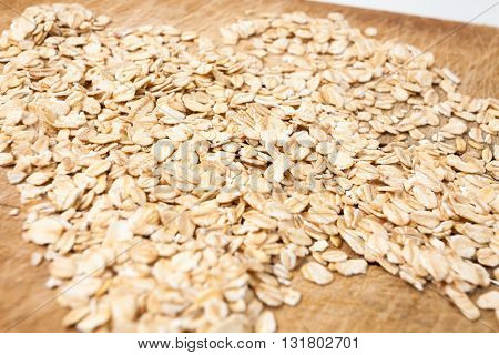 Raw oats wooden cutting board background package.