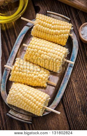 Corn Cob For Grill On Wooden Table