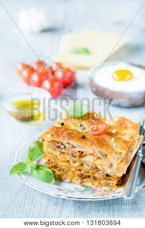 Photos of homemade lasagna on rustic background