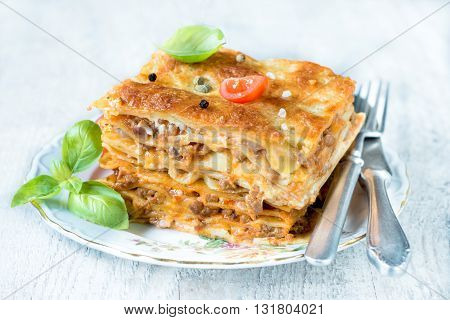 Photos of lasagna time on rustic background