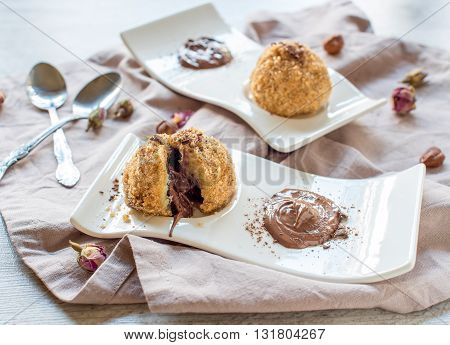 Photos of nougat dumplings on rustic background