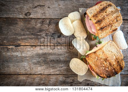 Photos of pub sandwiches on rustic background