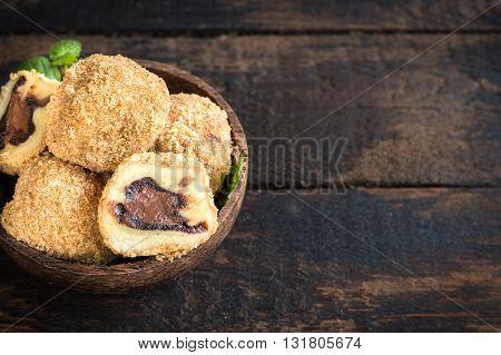 Photos of sweet dumplings on rustic background