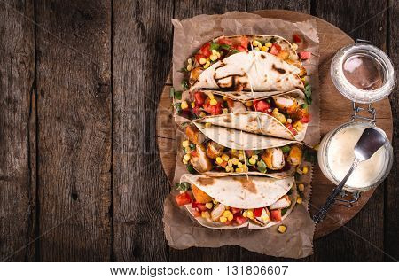 Photos of wrap sandwiches on rustic background