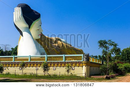 Bago, Myanmar - January 10, 2012: The huge statue of the reclining Buddha (Shwethalyaung Buddha)