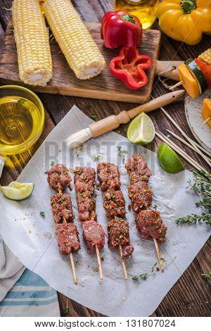 Marinate Beef Kebabs On Wooden Table