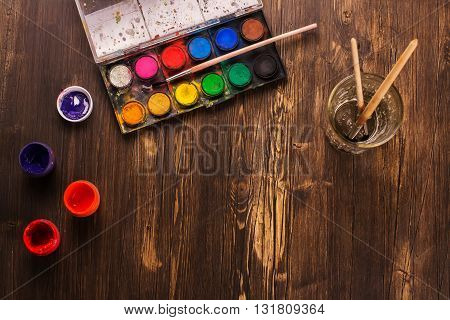 Back to school: paints, brushes, paper. Artist tools. Art concept