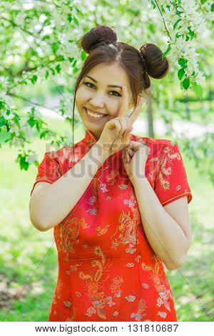 Beautiful Asian Girl In Traditional Chinese Red Dress.