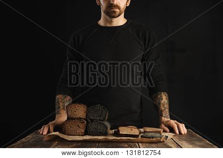 Unrecognizable Bearded Tattooed Man Sales Freshly Baked Diet Healthy Breads: Charcoal And Rye With F