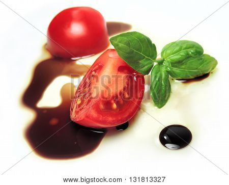 fresh tomato slice with oil and balsamic vinegar.
