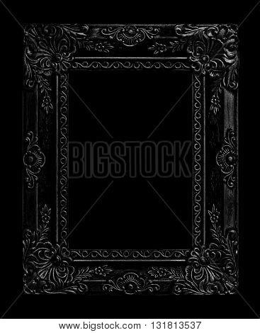The antique black frame on the black background